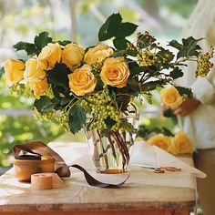 Cutting Garden Roses -  Berry-laden viburnum branches, harvested from a backyard cutting garden, form a beautifully unstudied backdrop for a dozen yellow roses.  This would be lovely for a casual rehersal dinner or bridal shower as well.   -  [maybe I should have pinned it under 'Party']