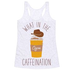 """What In The Caffeination - Show your loves of memes and coffee with this funny meme inspired tee shirt. This design features an illustration of a fancy latte wearing a tiny cowboy hat and the phrase """"What In The Caffeination."""""""
