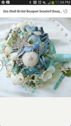 My bouquet style. Will be designed by Flower Girl Brooches. Ocean themed with more gold brooches, white Hydrangeas, burlap stem.