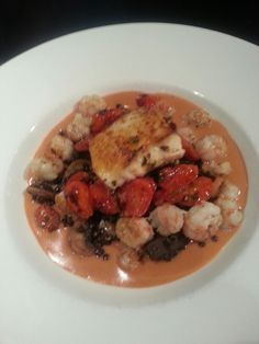 Pan seared Halibut and rock shrimp, cognac seafood broth, mushroom lentils with pan roasted grape tomatoes