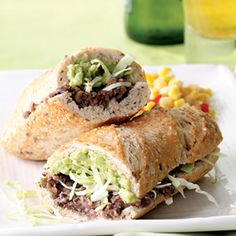 """Tijuana Torta--A Mexican-style torta is just like a burrito, except the """"wrapper"""" is a hollowed-out roll instead of a tortilla. Here it's filled with mashed spiced black beans and a quick guacamole. Take this vegetarian version to another level (and add calcium) by melting Monterey Jack cheese onto the bean side of the sandwich."""
