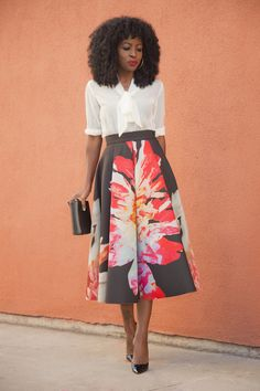 Tie front blouse & floral midi skirt. So ladylike!