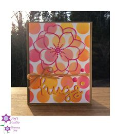 https://flic.kr/p/GBzW5d | Bright & Happy Hello Card | I made this card using the Simon Says Stamp Extra Large Dots Stencil on which I blended 3 different distress inks to make the bright background. The floral image is from the SSS/ Winnie & Walter collaboration stamp set, Big Bloom, which I heat embossed on vellum with Magenta Ranger Embossing Powder. The Hugs is cut from a Lawn Fawn die using two different colors of paper to give it a shadow. I am entering this into the current SSS Fl...