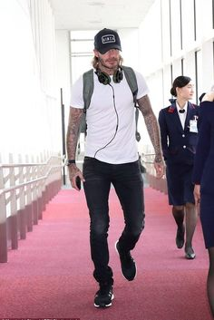 David Beckham wearing The Park-Ing Ginza Hat, Saint Laurent Skinny-Fit 15cm Hem Stretch-Denim Jeans in Black, Adidas Iniki Runner in Core Black and Adidas Urban Utility Backpack in Olive