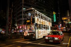 Double deck tram in Hong Kong - Double-Deck tram in Hong Kong, China. each one with a different look, all great and fun.