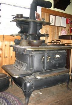 this is an old-fashioned wood burning cooking stove with all of the