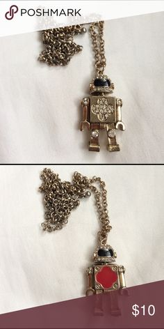 "❤️SALE❤️ Robot Necklace Selling a robot necklace in a dark gold color.  The chain is about 24"" and rests at the top of the ribcage when worn.  One side of the robot pendant has little crystals in a clover pattern on the middle part and little crystals on the legs, arms and face.  The other side has a red clover pattern.  The head swivels to rest on whichever side you feel like wearing, and the arms and legs move as well.  Bought in Japan and barely used.  Cute necklace that gives any outfit…"