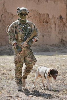 An Australian soldier & his dog from the 2nd Cavalry Regiment Task Force provide security during a shura at Kajran in Daykundi province. Photo by Cpl. Mark Doran, Australian Defence Force.