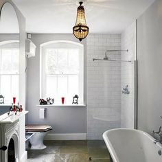 Great Blog for Small Spaces.. Also..check out this bathroom..fireplace and toilet top.