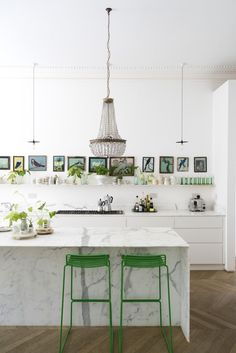 A luminous Victorian home filled with plants in London. Love white and green in a kitchen