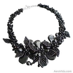 This sophisticated necklace features a floral bouquet made of black onyx and agate gemstones. This necklace was handmade in Thailand by artisan Lai.  ~Black Agate & Black Onyx Bouquet Floral Motif Necklace~ SKU: NS-0317-BLK