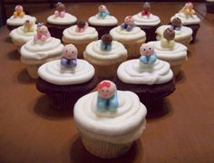Chocolate and Vanilla cupcakes with Fondant Babies.