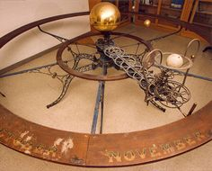An Orrery is a mechanically driven scientific instrument or model that illustrates the relative positions and movements of the planets and their moons ...