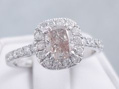 This is our amazing 1.45 ctw Cushion Cut Diamond Engagement Ring. It has an exquisite 0.93 carat Cushion Cut Center Diamond that is H Color/SI2 Clarity, Clarity Enhanced (Fracture Filled) Center Diamond. It is set in 14K White Gold with 0.52 cts of accent diamonds in a gorgeous custom designed setting. It is listed for $2,390. Cushion Cut Diamonds, Clarity, Heart Ring, Custom Design, Favorite Things, White Gold, Engagement Rings, Amazing, Color