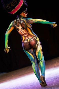 A painted model poses for photographers on the final day at the 2011 World Bodypainting Festival on July 3, 2011, in Poertschach, Austria. The festival, which has taken place since 1998, drew body painting artists from 40 different nations.