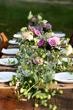 The Everygirl's Backyard Wedding // styling by Amber Whitehouse // rustic elegance // purple and green centerpieces // floral arrangements // photography by Jen Dederich Photography