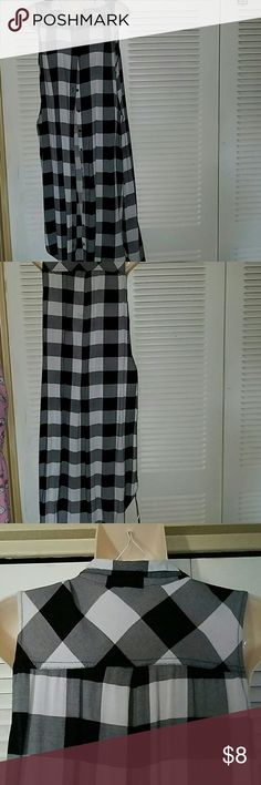 Cotton express black check blouse Grey blouse it's great when you want to wear and what types of has a slit on each side the material is 100% rayon cotton Express Tops Blouses