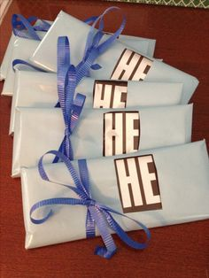 Hershey bar favors for baby boy shower. Maybe color HE in blue instead of wrapping. Tie cute bow.  girls same idea