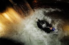 Blackwater Tubing through a dark cave in New Zealand.  You drop down water falls and just flow with the river.  Guided Tour.
