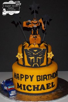 "Transformers ~ Bumble Bee - 6"" & 8"" cakes iced in fondant dyed golden yellow. All decorations were hand cut out of fondant. The Transformer figures are plastic. TFL!"