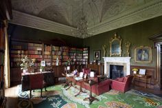 In the library of Ireland's Russborough House, a plaster ceiling by Paolo and Filippo Lafranchini dates from the 18th century, and the colorful rug was commissioned in 1952 from Madrid's Royal Tapestry Factory.