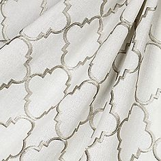 Fancy Fretwork - Silver Classic quatrefoil trellis embroidered in silver on dark beige linen-like ground. Every room can use a little glitz and glamour! This embroidered silver quatrefoil fabric is available by the yard and on most Loom custom furnishi Dark Beige, Drapery Fabric, Quatrefoil, Grey Fabric, Fabric Design, Loom, Upholstery, Candle Holders, Yard