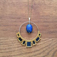 Long necklace, gold plated 14 k Gold filled adorned with a creole pendant 3.5 cm adorned with a weaving Miyuki glass beads and a natural Lapis Lazuli. Length: 72 cm Virtues of Lapis Lazuli: this is a stone of balance, healing, control and repair. Symbol of protection, it helps to go