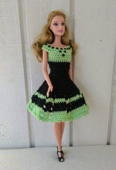 Handmade dress for Barbie doll by my own design. Crocheted dress made of black yarn in combination of light green yarn. The dress is decorated with black stones at the front. Fastened at the back by two snap buttons. Doll and shoes is NOT included. Crochet Doll Dress, Crochet Barbie Clothes, Doll Clothes Barbie, Barbie Dress, Barbie Patterns, Doll Clothes Patterns, Clothing Patterns, Lany, Handmade Dresses