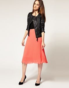 Love the girly pleats balanced with black leather. River Island Pleated Midi Skirt, $64.01