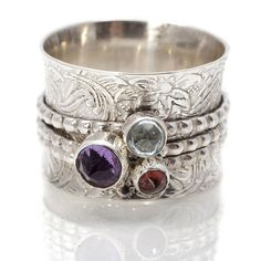 handmade gemstone silver spinning ring by charlotte's web | notonthehighstreet.com