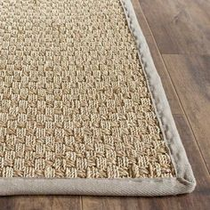 Nothing says beach-chic like textures found from the shore! This lovely rug is crafted from seagrass for a natural look that blends understated elegance with coastal charm. Brimming with organic appeal, it's the perfect foundation for your ocean-inspired aesthetic. The neutral hue lets this piece beautifully blend in with a variety of looks, while the woven design and subtle gray border anchors it in coastal style. Try rolling this lovely design out in your living room to set a foundation...