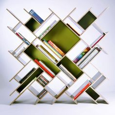 Quad Shelving Unit by Nauris Kalinauskas    Source: gnr8.biz I have to study this some. Could be an interesting bookshelf.