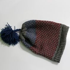 "Kids Hat - Unique kids hat by ""Natyra Knitting Prizren"". It is very soft, cozy and warm and can be wear by girls or boys. Is made from grey yarn but also has a design with blue and red thread. It can be a birthday or Christmas gift and by buying it, you will make your kid look very happy and very fashionable too!"