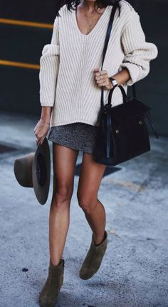 Andi + sweater and skirt trend + super cosy knit jumper + mini skirt + suede boots + wide brimmed hat + elegant simplicity of this style! Knit: Acne Studios, Hat: Janessa Leone, Boots: Dicker.