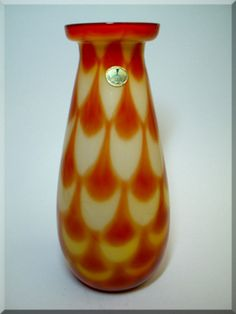 Elme Glasbruk orange + yellow Swedish glass 'peacock' vase, with George Hardy Swedish Art Glass import label.