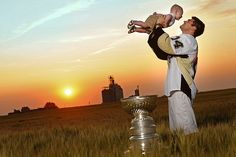 Chris Kunitz and his son Zachary, along with the Stanley Cup