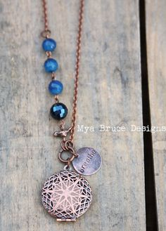 Antique Copper DIFFUSER necklace - long antiqued copper design with blue stones and bird worked into the chain, with breathe pendant