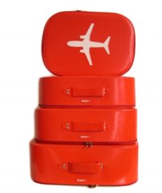 Sleek suitcases in our favorite color...Virgin Red.