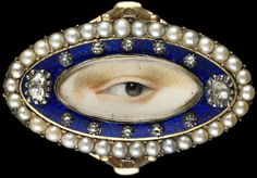 The Look of Love: Exquisite in craftsmanship, unique in detail, and few in number, lover's eye miniatures are small-scale portraits of individual eyes set into various forms of jewelry from late 18th- and early 19th-century England. Rose gold oval ring surrounded by a blue enamel border containing ten small and two large diamonds enclosed in a border of natural split pearls, ca. 1790. Brown left eye. Purchased from Edith Weber, New York. Dimensions: 3⁄4 × 1 1⁄4 × 7⁄8 in.
