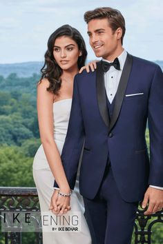 Style#: 417  The Navy 'Hudson' Tuxedo is perfect for formal events and weddings! It features a single button front, black satin shawl lapel, black satin besom pockets, side vents, slim fit construction, and fashioned from luxuriously soft navy Super 120's Wool, this tuxedo is not only striking and powerful, it's also the newest of our navy tuxedo options! Don't forget to check out the Sebastian and BlakeTuxedos, as well as the Collin suit, which are all part of the same...