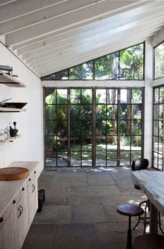 Kitchen with doors onto the backyard. Stone was salvaged from same place as the coney isalnd boardwalk. Shelves are reclaimed scaffolding.