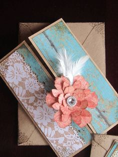 Coral and mint outer invite with paper flower and feather (Absolutely beautiful and tied in perfectly with our colors and theme!)
