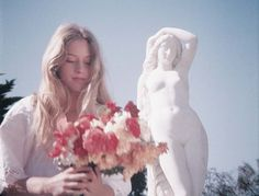 Miranda collects flowers in a scene cut from Picnic at Hanging Rock