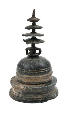 <b>A BRONZE RELIQUARY IN THE FORM OF A STUPA, NORTHWEST PAKISTAN, REPORTEDLY FROM THE SWAT VALLEY,  GANDHARA, 1ST CENTURY</b> <br /> Consisting of a round base, a round drum and a hemispherical dome supporting a series of parasols of diminishing size, 8.5cm high <br />  <br />