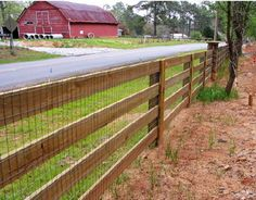 rough sawn fence rails and post with welded wire attached