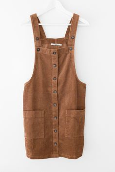 - Soft corduroy dress overalls - Button down front - Large front pockets - Strap length is adjustable - Loose fitting - 100% Cotton - Imported
