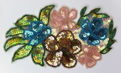 A beautiful sequin motif. A flower and leaf design created in iridescent sequins in stunning, subdued colours. Each part of the design is outlined in a single row of tiny seed beads. The sequins are securely attached to an interfacing backing. Leaf Design, Iridescent, Seed Beads, Embellishments, Sequins, Colours, Create, Flowers, Vintage