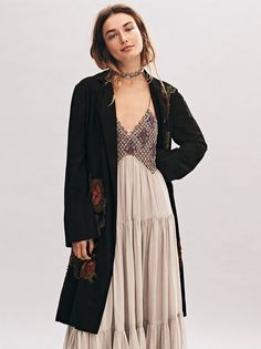 Rose Suede Trench | Suede trench with a long silhouette and an effortless belt at the waist. Features romantic floral applique accents throughout. Side pockets. Lined.