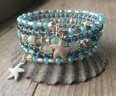 Oceanic Blues Multi Strand Memory Wire Coil Bracelet With Starfish Charms