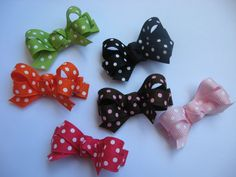 """High quality and stylish set of six 2"""" hairbows. This set includes: One of each polka dot color as shown -green, orange, black, brown/pink, hot pink and light pink. Perfect to wear to one side to hold back bangs. Placed on partially lined double prong alligator clip. No slip grip can be added on ..."""